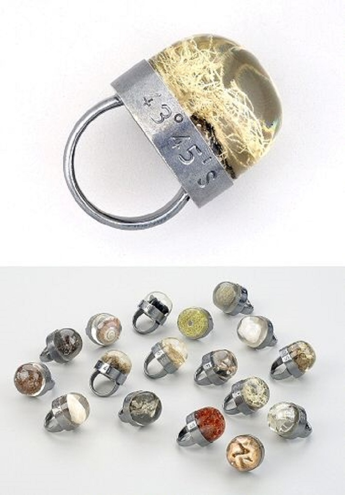 Rings showcasing bits of the landscape in resin, engraved with the source coordinates